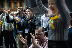 © Licensed to London News Pictures . 26/05/2019. Manchester, UK. Liberal Democrat Party supporters cheer as they watch results on TV screens in the counting hall . The count for seats in the constituency of North West England in the European Parliamentary election , at Manchester Central convention centre . Photo credit: Joel Goodman/LNP