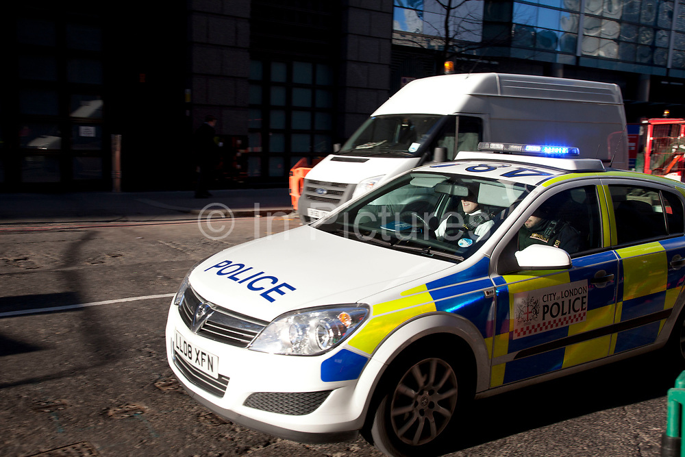 Police car passed at speed in the City of London. The City of London Police is the territorial police force responsible for law enforcement within the City of London, England, including the Middle and Inner Temple. The service responsible for law enforcement within the rest of Greater London is the Metropolitan Police Service, a separate organisation. The City of London, which is now primarily a financial centre with a small resident population but a large commuting workforce, is the historic core of London, and has an administrative history distinct from that of the rest of the metropolis, of which its separate police force is one manifestation.