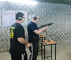 Students practise at a gun range on day seven on the Train & Travel in Israel, on Thursday 6th Jan 2011. Train & Travel is a unique ten day program designed for IKMF's instructors, students & guests, interested in combining Krav Maga training with a tour of the holy land. ©2011 Michael Schofield. All Rights Reserved.