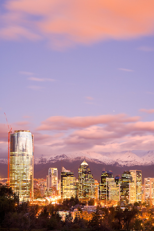 Skyline of modern office buildings at Las Condes and Providencia districts with snowed Andes mountain Range in the back, Santiago, Chile, South America <br /> <br /> For LICENSING and DOWNLOADING this image follow this link: http://www.masterfile.com/em/search/?keyword=700-03178827&affiliate_id=01242CH84GH28J12OOY4<br /> <br /> For BUYING A PRINT of this image press the ADD TO CART button.<br /> <br /> Download of this image is not available at this site, please follow the link above.