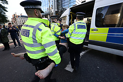 © Licensed to London News Pictures. 25/10/2021. London, UK. Insulate Britain climate change activists being arrested for blocking traffic on Bishopsgate in the City of London. The group have restarted their actions to block motorways and major roads causing disruption in the week before the COP26 climate meeting in Glasgow on 31/10/2021. Photo credit: Ben Cawthra/LNP