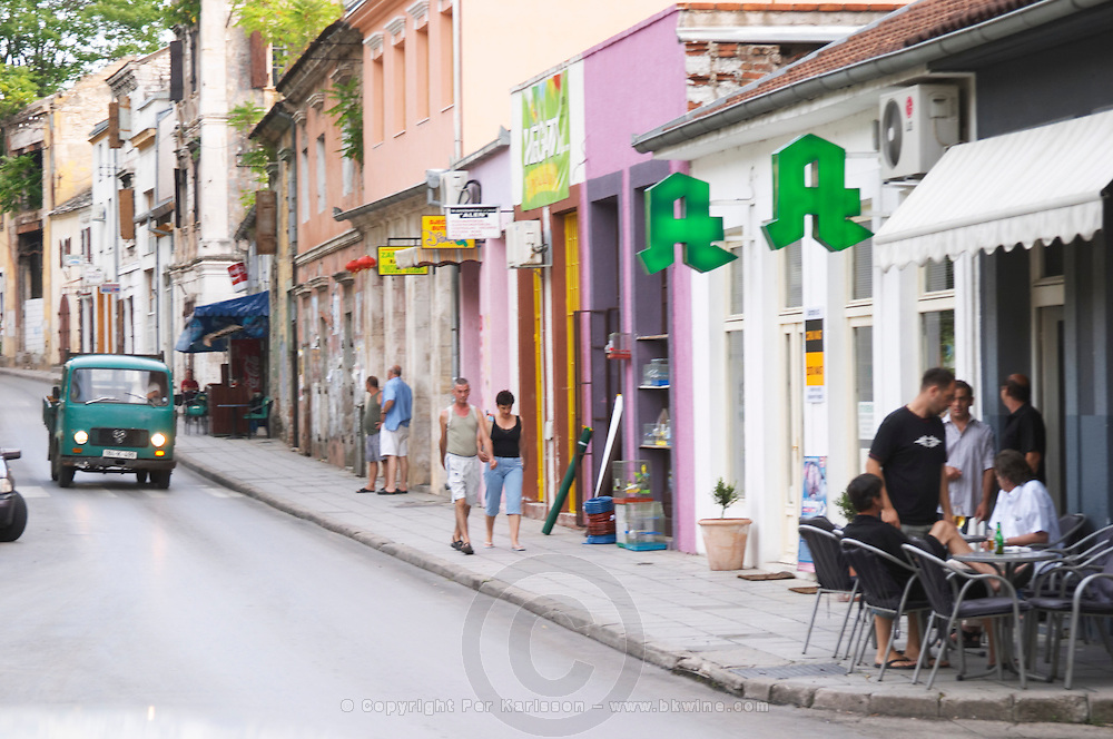 View Along Marsala Tita Tito street. Pedestrians and people sitting drinking beer at a cafe. Historic town of Mostar. Federation Bosne i Hercegovine. Bosnia Herzegovina, Europe.