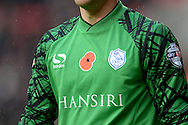 a close up showing A Remembrance Sunday Poppy on Goalkeeper Keiren Westwood of Sheffield Wednesday. Skybet football league championship match, Charlton Athletic v Sheffield Wednesday at The Valley  in London on Saturday 7th November 2015.<br /> pic by John Patrick Fletcher, Andrew Orchard sports photography.