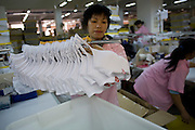 Chinese women pack bras for export to the United States in the shipping area of the Top Form factory in Longnan, China
