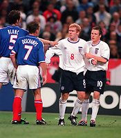 Paul Scoles (England) is held back by Nick Barmby after a strong challenge from Deschamps. France v England 2/9/2000. Credit: Colorsport / Andrew Cowie.
