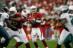 18 Jan 2009: Arizona Cardinals quarterback Kurt Warner #13 looks for a receiver during the NFC Championship game against the Philadelphia Eagles on January 18th, 2009. The Cardinals won 32-25 at University of Phoenix Stadium in Glendale, Arizona. (Photo by Brian Garfinkel)