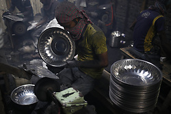 September 29, 2018 - Dhaka, Bangladesh - Worker polish steel made utensil at a factory near Keranigang as they work on these type's small factories on a very hazardous environment for low wages. (Credit Image: © MD Mehedi Hasan/ZUMA Wire)