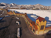 SHOT 3/2/17 7:51:02 AM - Aerial photos of Park City, Utah. Park City lies east of Salt Lake City in the western state of Utah. Framed by the craggy Wasatch Range, it's bordered by the Deer Valley Resort and the huge Park City Mountain Resort, both known for their ski slopes. Utah Olympic Park, to the north, hosted the 2002 Winter Olympics and is now predominantly a training facility. In town, Main Street is lined with buildings built primarily during a 19th-century silver mining boom that have become numerous restaurants, bars and shops. (Photo by Marc Piscotty / © 2017)