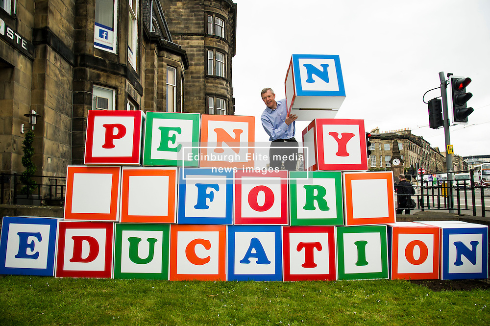 """Pictured: Willie Rennie<br /> <br /> Scottish Liberal Democrat leader Willie Rennie made his final pitch for votes today as he unveiled large building blocks that spelt out the party's flagship """"Penny for education"""" policy. Scottish Liberal Democrats HQ, 4, EH12 5DR. Adam Clarke 07450 980 386.the election on Thursday.<br /> <br /> Ger Harley   EEm 2 May 2016"""
