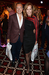 GRAHAM NORTON and TARA PALMER-TOMKINSON at a party to celebrate the publication of 'Passion for Life' by Joan Collins held at No41 The Westbury Hotel, Mayfair, London on21st October 2013.
