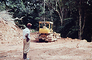 Caterpillar bulldozer repairing the road through rainforest blocked by landslide to Blanchisseuse, Trinidad early 1960s