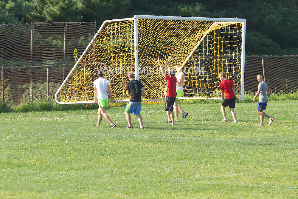 Central Valley, New York - Monroe-Woodbury High School runners move a soccer goal from the court before the Woodbury Country Ramble race on Aug. 26, 2012.