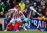 Marc Munisea of Stoke city (l) battles with Edimlson Fernandes of West Ham . Premier league match, Stoke City v West Ham Utd at the Bet365 Stadium in Stoke on Trent, Staffs on Saturday 29th April 2017.<br /> pic by Bradley Collyer, Andrew Orchard sports photography.