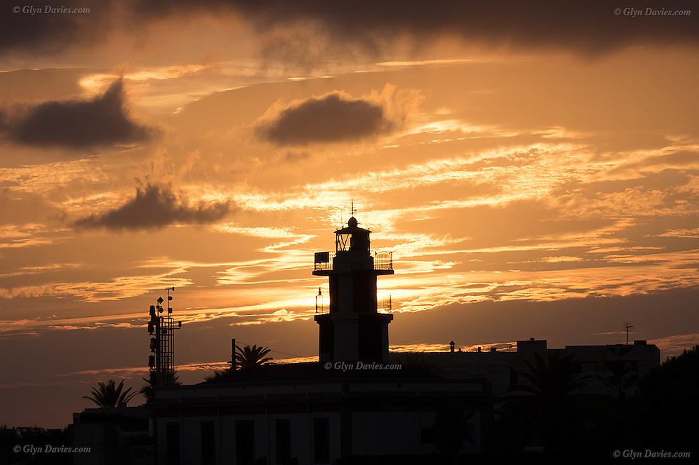 Sunset over Punta De Sa Farola Lighthouse, Ciutadella, Menorca.