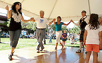 Andrea and George Condodemetraky, Connie Cardasis, A'Lynn Hayward and Karen Barrett join in some traditional Greek dancing during Laconia's 10th annual Multicultural Market Day on Saturday at Rotary Park.  (Karen Bobotas/for the Laconia Daily Sun)