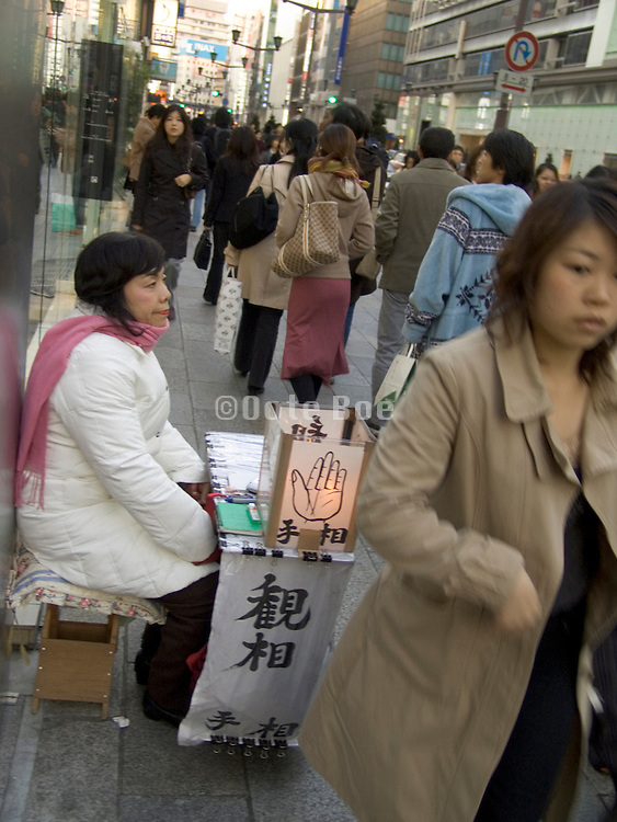 hand and face fortune teller in the streets of Ginza Tokyo