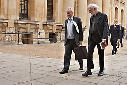 © Licensed to London News Pictures.  23/02/2012. OXFORD, UK. The Archbishop of Canterbury Dr Rowan Williams (pictured right) and prominent atheist and author of The God Delusion Professor Richard Dawkins (pictured left) arriving for a debate about'The nature of human beings and the question of their ultimate origin' at Oxford University today (12/02/2012). Philosopher Sir Anthony Kenny (not pictured) will chair the debate in the Lucas Room of the Sheldonain Theatre, Oxford University.  Photo credit :  Cliff Hide/LNP