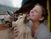 Volunteer Emma Kauzman from Denver, Colorado recieves a kiss from one of the shelter's dogs.