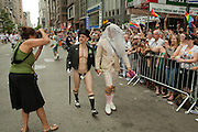 A couple ready to take their places in the 2011 Pride Parade on New York's Fifth Avenue pose for a photo opportunity.