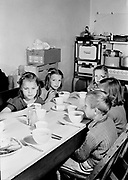 0003-017. Lunchtime. Students eating lunch in the Evaline Elementary school, near Winlock, Washington. The photographer, Stuart Fresk, was a teacher there from 1935 to 1946.