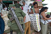 06 OCTOBER 2003 -- TAPACHULA, CHIAPAS, MEXICO:  Mexican soldiers search people from Guatemala who crossed the Rio Suchiate illegally to enter Mexico near Tapachula, Mexico. Tapachula is center of the smuggling industry between Mexico and Guatemala. Consumer goods are smuggled south to Guatemala (to avoid paying Guatemalan import duties) and people are smuggled north into Mexico. Most of the people coming north are hoping to eventually get to the United States. PHOTO BY JACK KURTZ