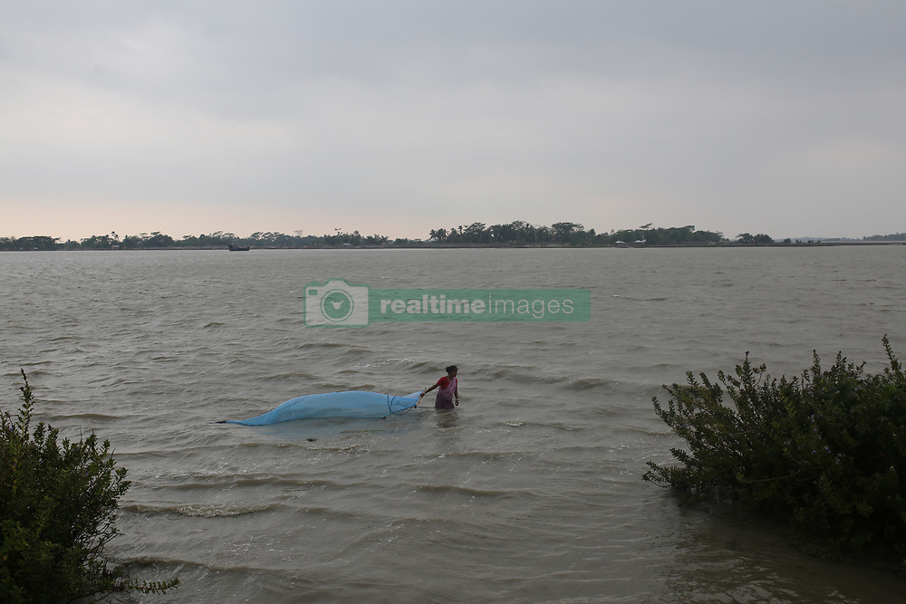 May 4, 2019 - Khulna, Bangladesh - A woman fishing in the Shibsha river at Dakop after Cyclone Fani hits in Khulna, Bangladesh on May 4, 2019. (Credit Image: © Rehman Asad/NurPhoto via ZUMA Press)