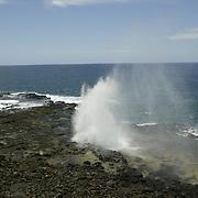 Exploring and enjoying the beach and coastline of Kauai in Poipu Beach. A blowhole on the island of Kauai.
