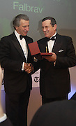 Arnaud Bamberger presenting Luciano Silece the award for the Older horse. Cartier Racing Awards 2003. four Seasons hotel, 12 November 2003. © Copyright Photograph by Dafydd Jones 66 Stockwell Park Rd. London SW9 0DA Tel 020 7733 0108 www.dafjones.com