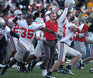 MORNING JOURNAL/DAVID RICHARD.Ohio State head coach Jim Tressel and his squad run onto the field after the Buckeyes' Big Ten win over host Michigan.
