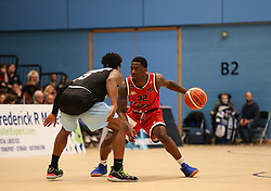Jalan McCloud of Bristol Flyers faced with Qunicy Taylor of Surrey Scorchers - Photo mandatory by-line: Arron Gent/JMP - 28/04/2019 - BASKETBALL - Surrey Sports Park - Guildford, England - Surrey Scorchers v Bristol Flyers - British Basketball League Championship