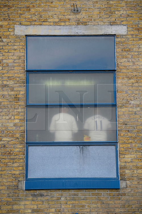 © Licensed to London News Pictures. 14/05/2017. London, UK. A number 11 shirt seen through the window at White Heart Lane, in North London where Tottenham Hotspur F.C. are playing their final game at the ground, against Manchester united today (Sun). Known as 'The Lane', Tottenham have been playing at the ground for 118 years, but will be playing at Wembley next season while a new 60,000 seat stadium is built for the start of the 2018/19 season.  Photo credit: Ben Cawthra/LNP