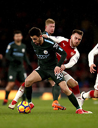 Manchester City's Bernardo Silva (left) and Arsenal's Aaron Ramsey (right) battle for the ball