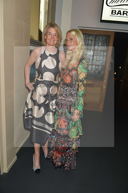 Left to right, HILARY WESTON and POPPY DELEVINGNE at the Tiffany & Co. Exhibition 'Fifth And 57th' Opening Night held in The Old Selfridges Hotel, Orchard Street, London on 1st July 2015.