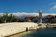 Bridge leading to the town of Nin, Biokovo mountains in background. Nin, Croatia
