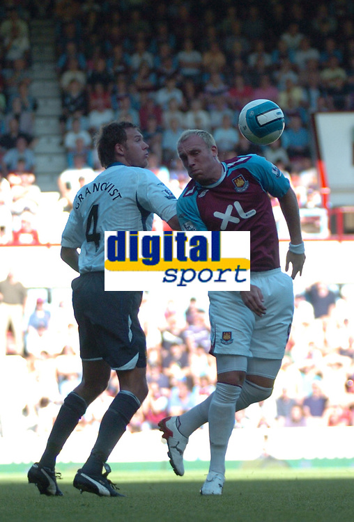 Photo: Tony Oudot.<br /> West Ham United v Wigan Athletic. The FA Barclays Premiership. 25/08/2007.<br /> Dean Ashton of West Ham with Andreas Granqvist of Wigan