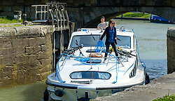 A cabin cruiser enters a lock on the Canal du Midi in Carcassonne, France<br /> <br /> (c) Andrew Wilson   Edinburgh Elite media