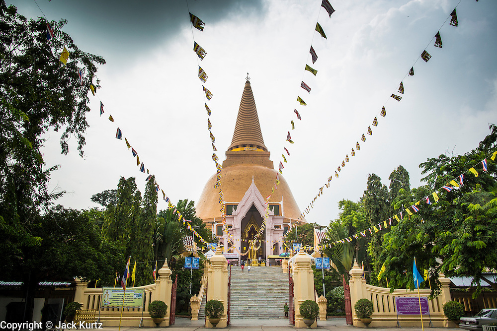 12 OCTOBER 2012 - NAKHON PATHOM, NAKHON PATHOM, THAILAND:  Phra Pathom Chedi in Nakhon Pathom. The Phra Pathom Chedi in Nakhon Pathom was commissioned by King Mongkut and completed by King Chulalongkorn in 1870. The chedi is 127 meters tall and is one of the tallest pagodas in the world. It is located in the center of the city of Nakhon Pathom and has been an important Buddhist center since the 6th century. According to local history, Nakhon Pathom is where Buddhism first came to Thailand.     PHOTO BY JACK KURTZ