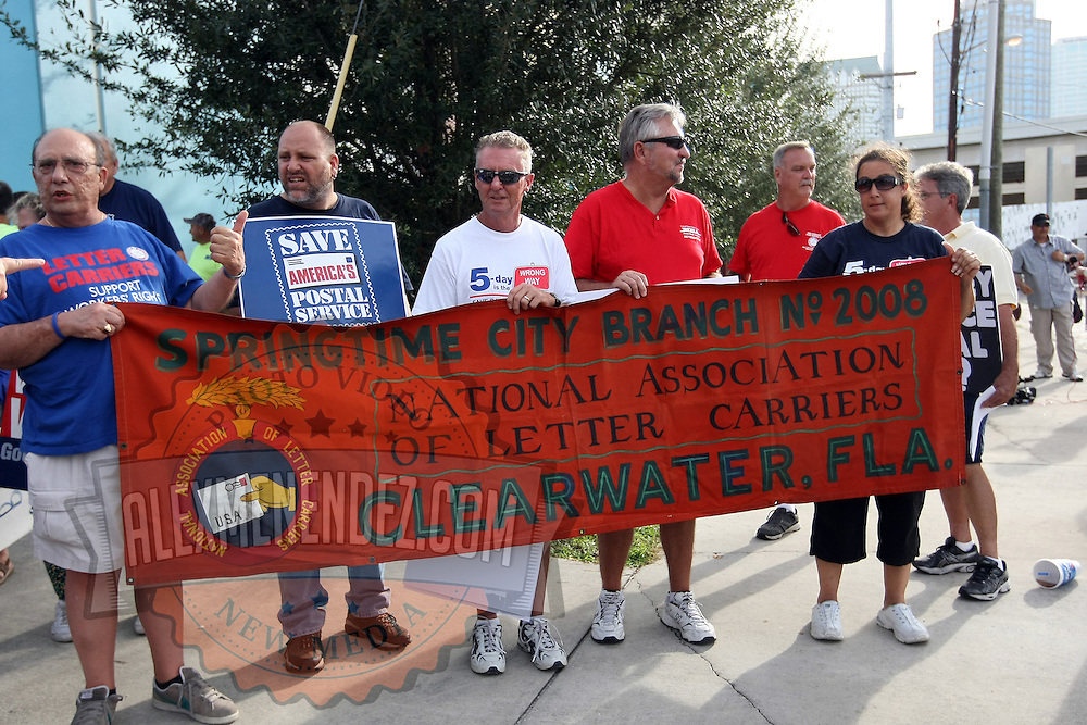 Letter carriers walk in the parade during the Republican National Convention in Tampa, Fla. on Wednesday, August 29, 2012. (AP Photo/Alex Menendez)