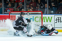 KELOWNA, BC - JANUARY 4: Matthew Wedman #20 of the Kelowna Rockets takes a shot and slides into the net of David Tendeck #30 as Michal Kvasnica #38 of the Vancouver Giants attempts to clear the puck from the crease during second peirod at Prospera Place on January 4, 2020 in Kelowna, Canada. (Photo by Marissa Baecker/Shoot the Breeze)
