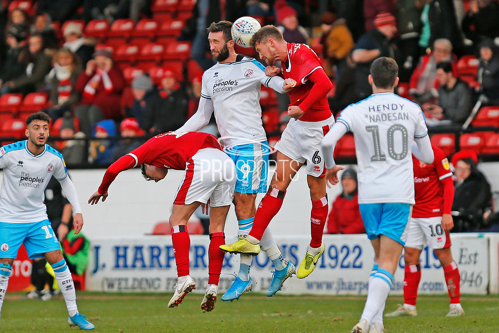 Ollie Palmer and Dan Scarr compete for the ball in the air during the EFL Sky Bet League 2 match between Walsall and Crawley Town at the Banks's Stadium, Walsall, England on 18 January 2020.