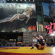 Kyle Snyder, (top), USA, in action against Khadjimurat Gatsalov, Russia, during the 'Beat The Streets' USA Vs The World, International Exhibition Wrestling in Times Square. New York, USA. 7th May 2014. Photo Tim Clayton