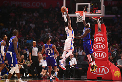 October 19, 2018 - Los Angeles, CA, U.S. - LOS ANGELES, CA - OCTOBER 19: Oklahoma City Thunder Forward Paul George (13) goes up for a dunk over Los Angeles Clippers Center Montrezl Harrell (5) during a NBA game between the Oklahoma City Thunder and the Los Angeles Clippers on October 19, 2018 at STAPLES Center in Los Angeles, CA. (Credit Image: © Brian Rothmuller/Icon SMI via ZUMA Press)