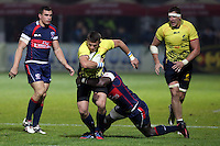 Takudzwa Ngwenya (R) of USA tries to stop  Adrian Apostol (C) of Romania  during their  rugby test match, on National Stadium Arc de Triomphe in Bucharest, November 8, 2014.