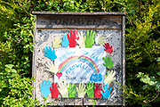 Poster of thanks - helping hands and rainbow - by local village people in praise of the National Health Service - NHS - during Coronavirus COVID-19 virus pandemic