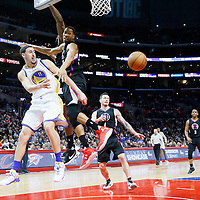 20 February 2016: Golden State Warriors guard Klay Thompson (11) passes the ball around Los Angeles Clippers forward Wesley Johnson (33) to Golden State Warriors forward Harrison Barnes (40) during the Golden State Warriors 115-112 victory over the Los Angeles Clippers, at the Staples Center, Los Angeles, California, USA.