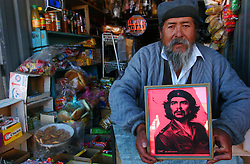 "The image of Che Guevara can be found in many places across Latin America, from local protests to tourist shops.  The symbol means many things to many different people.  Often times it is used as an anti-US image, representing sovereignty and freedom.  Santiago Rojas keeps an image of Che in his roadside snack shop because he ""likes his words, and his way of living.  He was prophetic, just like Jesus Christ""."