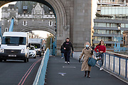 As Londoners await the second coronavirus national lockdown people still come to visit the sights such as Tower Bridge, some wearing face masks and some not, on what will be the last few days of normality before a month-long total lockdown in the UK on 2nd November 2020 in London, United Kingdom. The three tier system in the UK has not worked sufficiently, to suppress the virus, and there have have been calls by politicians for a 'circuit breaker' complete lockdown to be announced to help the growing spread of the Covid-19.