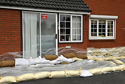 © Licensed to London News Pictures. 14/02/2014; Gloucester, UK.  House in Westend Parade in Alney Island which is subject to a Severe Flood Warning, threatened by rising water levels from the nearby river Severn.  The residents have been given sandbags by Gloucestershire Council.<br /> Photo credit: Simon Chapman/LNP