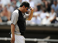CHICAGO - JULY 27:  Manager Ozzie Guillen #13 of the Chicago White Sox looks on after making a pitching change against the Detroit Tigers on July 27, 2011 at U.S. Cellular Field in Chicago, Illinois.  The White Sox defeated the Tigers 2-1.  (Photo by Ron Vesely)  Subject: Ozzie Guillen