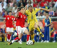 Photo: Chris Ratcliffe.<br /> Switzerland v Ukraine. 2nd Round, FIFA World Cup 2006. 26/06/2006.<br /> Andriy Voronin of Ukraine clashes with Johann Vogel of Switzerland.